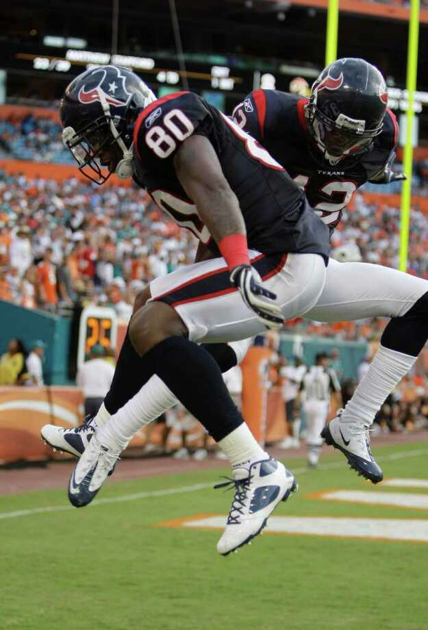 Houston Texans wide receiver Jacoby Jones (12) celebrates with Andre Johnson after Johnson scored a touchdown during the second half of an NFL football game against the Miami Dolphins, Sunday, Sept. 18, 2011, in Miami. (AP Photo/Lynne Sladky) Photo: Lynne Sladky, Associated Press / AP