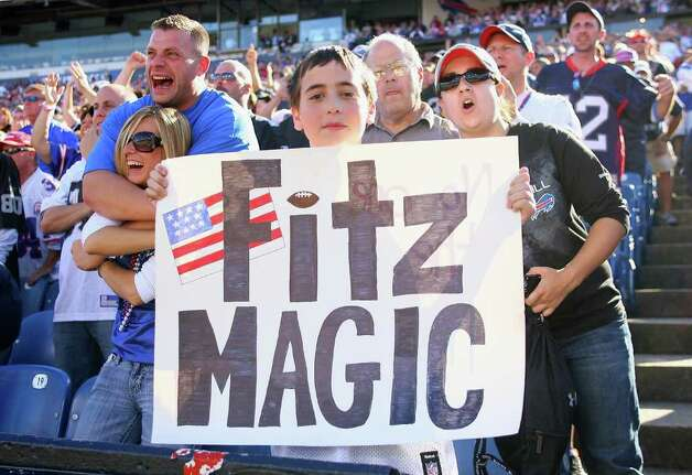 ORCHARD PARK, NY - SEPTEMBER 18: Fans of the Buffalo Bills show their support for their quarterback Ryan Fitzpatrick #14 against the Oakland Raiders at  Ralph Wilson Stadium on September 18, 2011 in Orchard Park, New York. Buffalo won 38-35. Photo: Rick Stewart, Getty Images / 2011 Getty Images