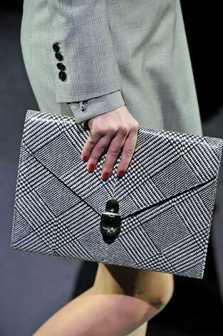 Salvatore Ferragamo details show off a handheld handbag from the Ferragamo collection and show in Milan. Trend: handheld handbag. Photo: Salvatore Ferragamo