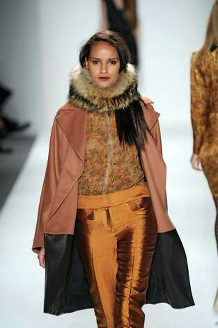 Cynthia Steffe hot spice colors from her ready to wear fall winter 2011-12 collection. Trend: hot spice colors and shimmer and fur embellishment. Photo: Cynthia Steffe