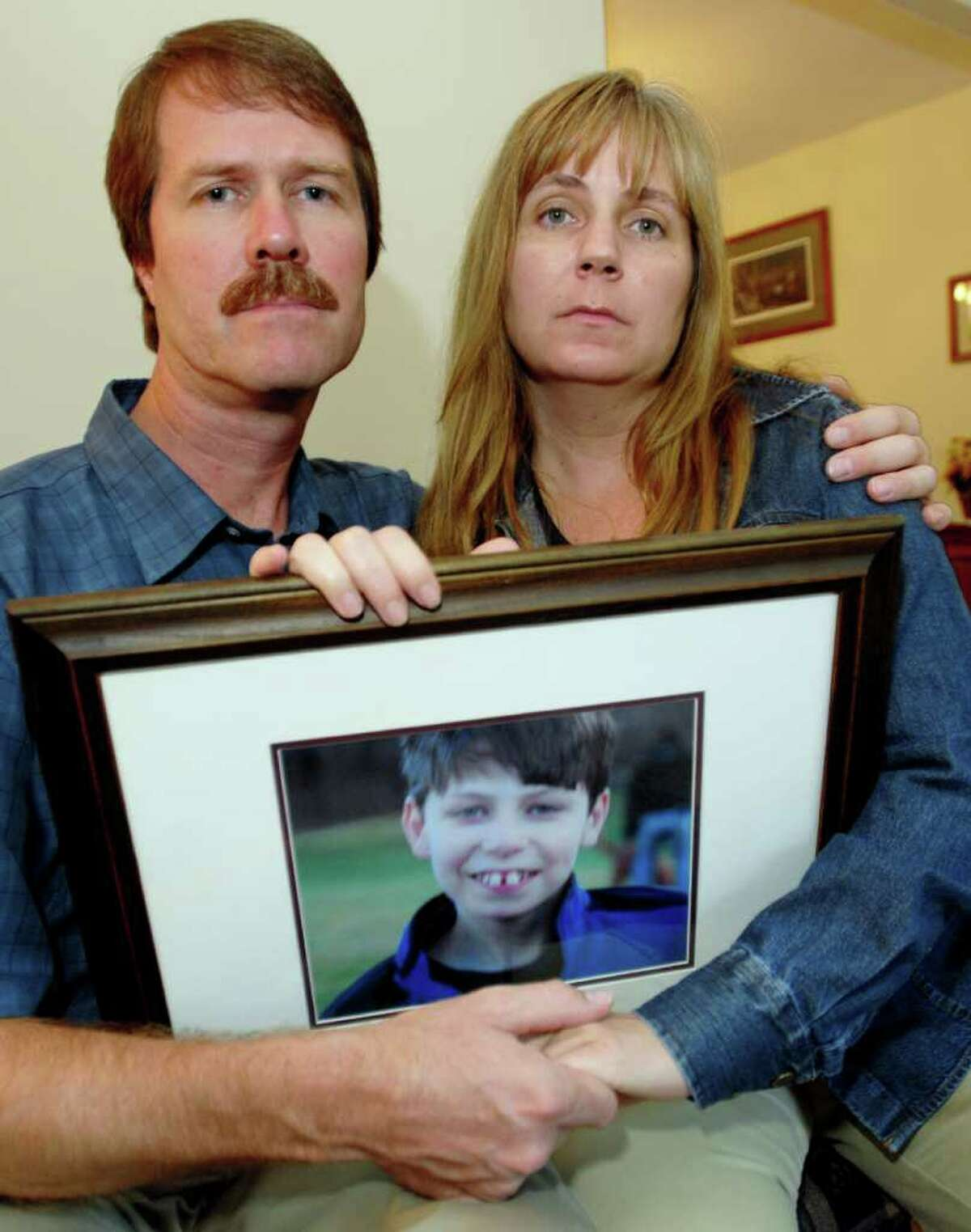 Michael and Lisa Carey hold a picture of their son, Jonathan. The 13-year-old, developmentally handicapped child died while in the care of an O.D. Heck caregivers on an outing to a mall on Feb. 15, 2007, when one of the men assigned to care for the boy allegedly sat on the child. (LUANNE M. FERRIS/TIMES UNION)