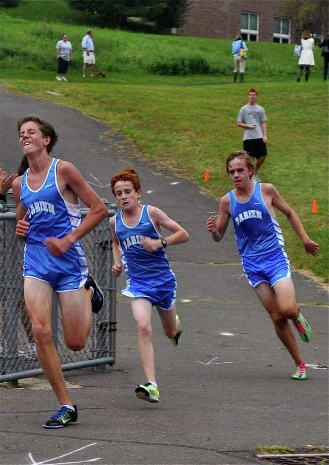 From left, Darien Boys cross country runners Michael Johnston, Alex Ostberg and Charlie Baird led the Blue Wave to a first place finish in their second meet of the season, as the team defeated the Hatters of Danbury High School for the first time since 2004 on Tuesday in Westport. Baird, Johnston and Ostberg finished first, second and third for the Blue Wave. Darien also defeated Staples and Norwalk to remain unbeaten at 5-0. Photo: Contributed Photo