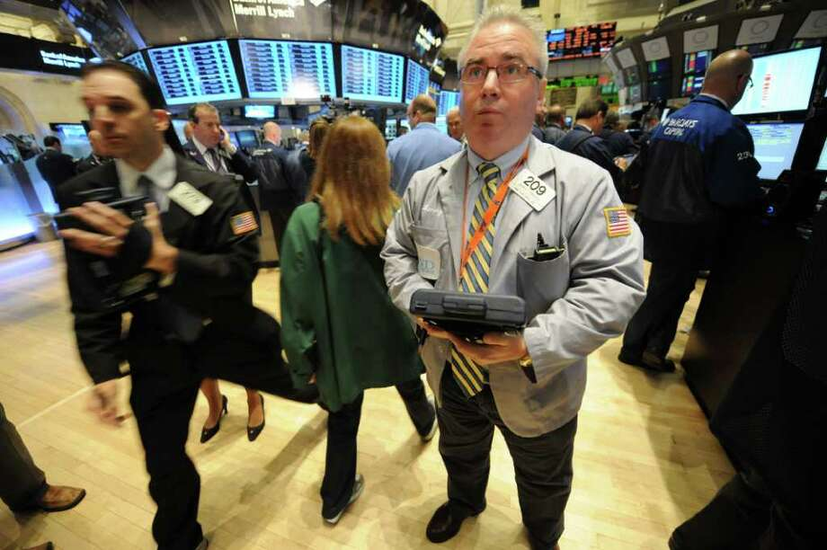 Trader James Dresch works on the floor of the New York Stock Exchange,Thursday, Sept. 22, 2011, in New York. (AP Photo/ Louis Lanzano) Photo: Louis Lanzano, ASSOCIATED PRESS / AP2011