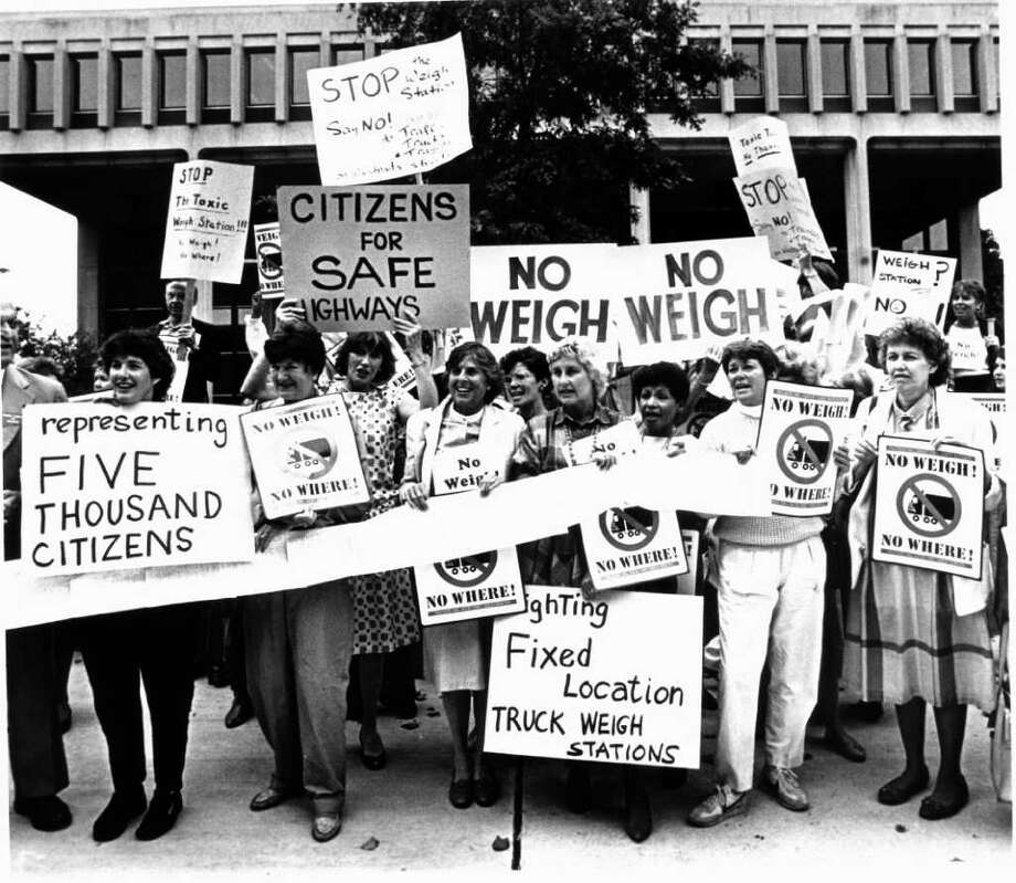 Oct. 1, 1986: At the U.S. District Courthouse in Bridgeport, Westport residents protest a weigh station on I-95 in Westport. A signed petition is wrapped around them. Photo: File Photo