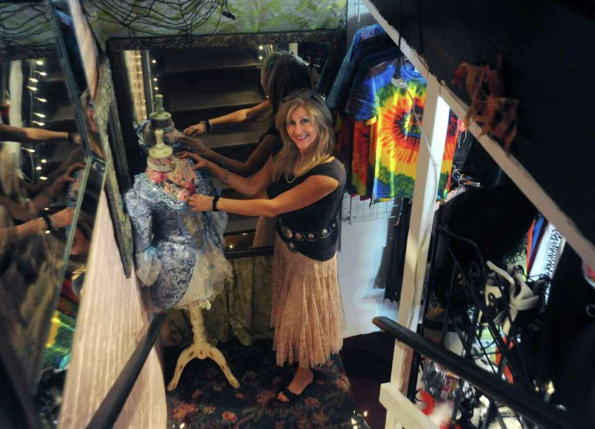 Sophia's Costumes is celebrating its 30th anniversary in business, as well as a recent remodeling and an increased internet presence. The shop sells costumes, antique clothing, vintage accessories, etc. and is run by Sophia Scarpelli. Scarpelli is pictured in her shop Thursday, Sept. 22, 2011.