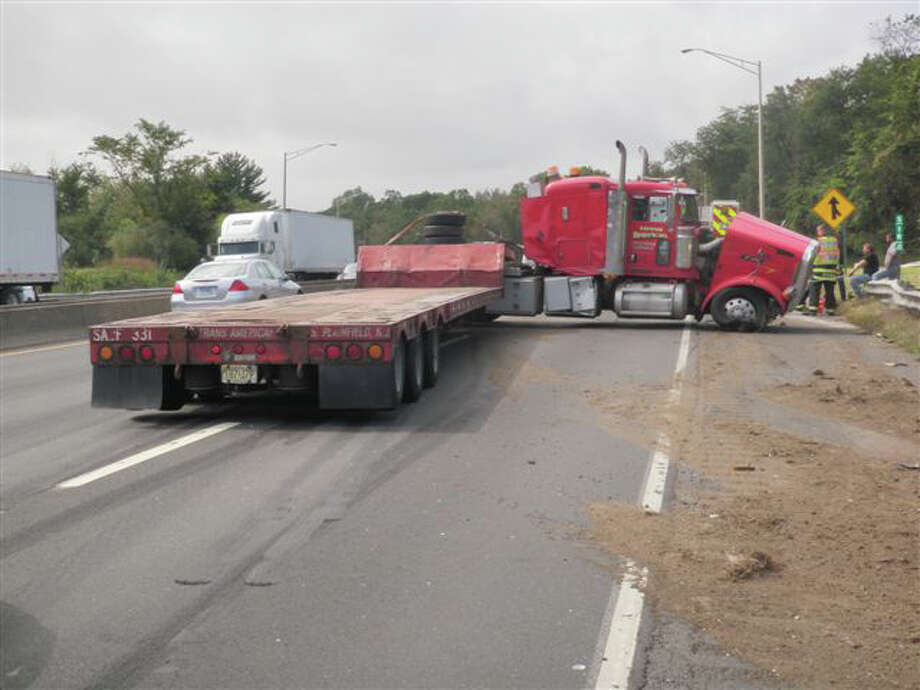 This tractor-trailer truck jack-knifed on Interstate 95 in Westport about 1 p.m. Thursday, colliding with a car and closing down two of the highway's three lanes. Photo: Westport Fire Department / Westport News contributed