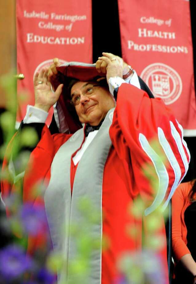 John J. Petillo, Ph.D, puts on his robes as he is installed as the sixth president of Sacred Heart University Wednesday, September 21, 2011 at the William H. Pitt Health and Recreation Center on the Universityís Fairfield campus. Photo: Autumn Driscoll