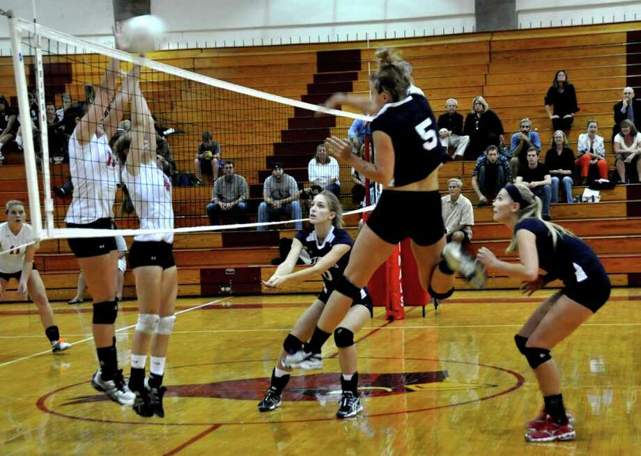 Anna Link, 5, displays her hitting prowess for Staples last Friday against Greenwich. Link has improved immensely and had five kills and seven digs Wednesday in a 3-0 victory over Westhill. Photo: Suzanne Kalb / Contributed Photo