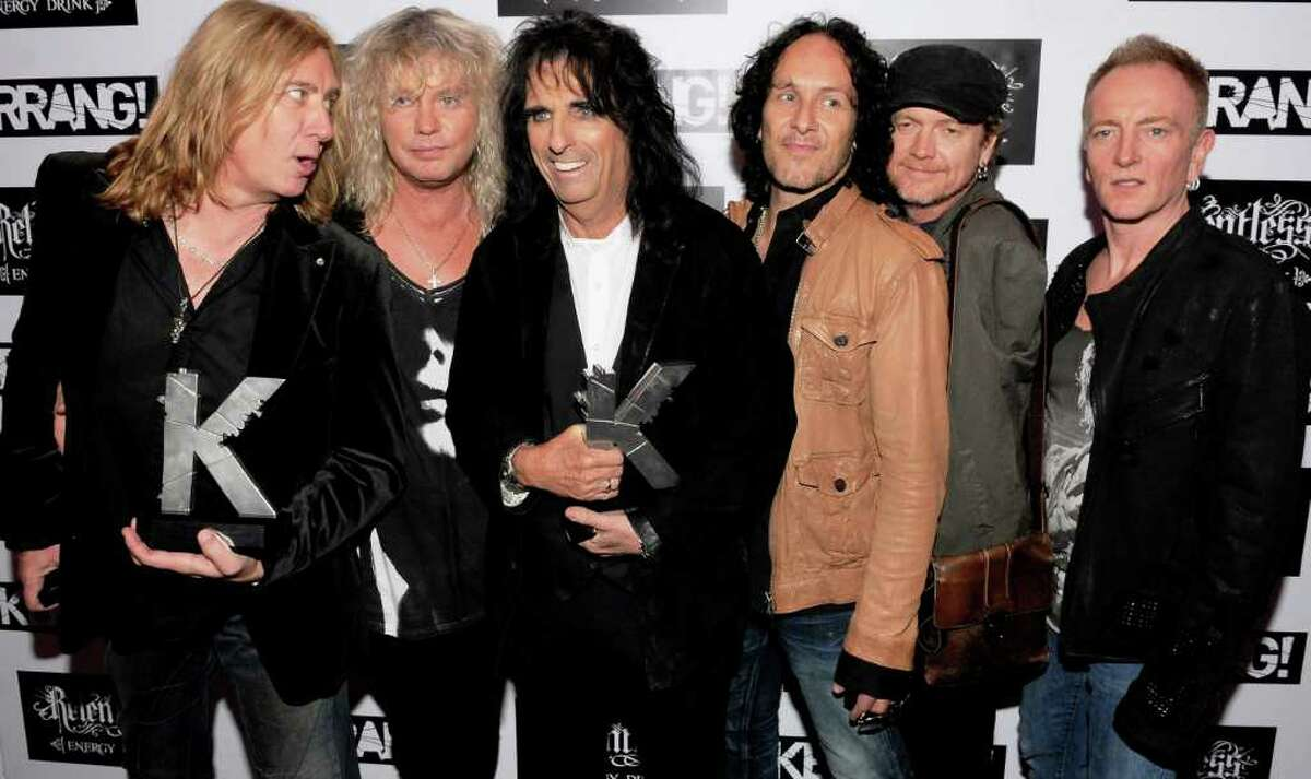 Alice Cooper (third from right) joins Def Leppard's Joe Elliott (from left), Rick Savage, Vivian Campbell, Rick Allen and Phil Collen during the Kerrang awards this summer in London. GETTY IMAGES