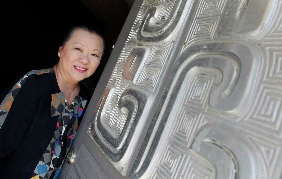 May Lam displays some of the metal panels given by the Chinese government for the Chinese pavilion at HemisFair '68. Nine of the panels have been installed as a mural on the Museum Reach across from the San Antonio Museum of Art. KIN MAN HUI / EXPRESS-NEWS Photo: KIN MAN HUI, SAN ANTONIO EXPRESS-NEWS / SAN ANTONIO EXPRESS-NEWS