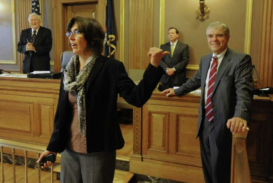 Judge Catherine Cholakis gives thanks for her nomination at the end of the Third District Republican Judicial Nominating Convention held at the Albany County Courthouse in Albany, N.Y. Thursday, Sept. 22, 2011. In back of her from the left are Chairman John Tabner, Secretary William Keniry and judicial nominee Guy Roemer. (Lori Van Buren / Times Union) Photo: Lori Van Buren