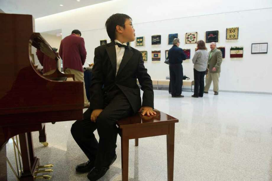 Sean Yu, 11, breaks from performing Bach during the grand opening of King's 3,500 square foot Performing Arts Center at King in Stamford, Conn., Sept. 21, 2011.  The theater features 454 seats, an orchestra pit, band room, choir room and rehearsal room. Photo: Keelin Daly / Stamford Advocate