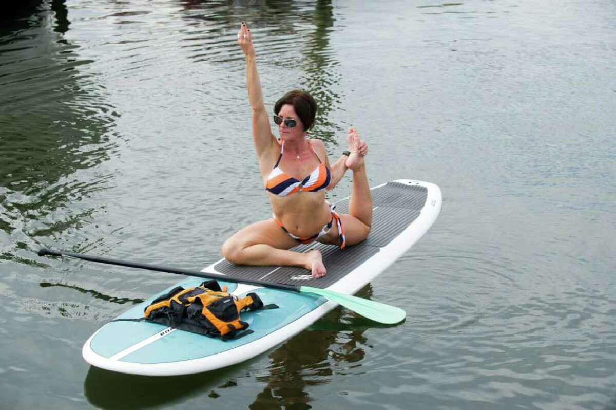 Yoga instructor Patricia Cuomo demonstrates her