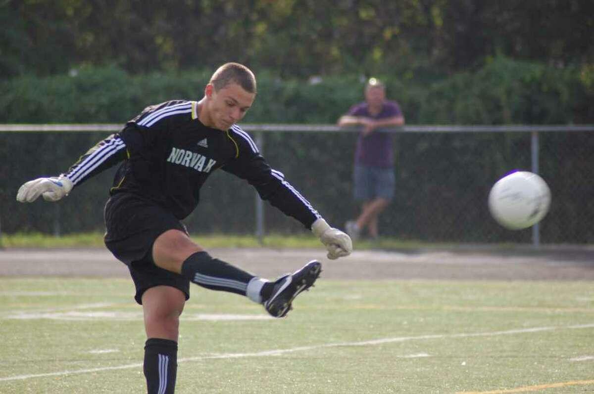 Goalkeeper Svet Kozak, of the Norwalk High boys soccer team, punts a ball during the first half of a 2-0 loss to Trumbull on Thursday.