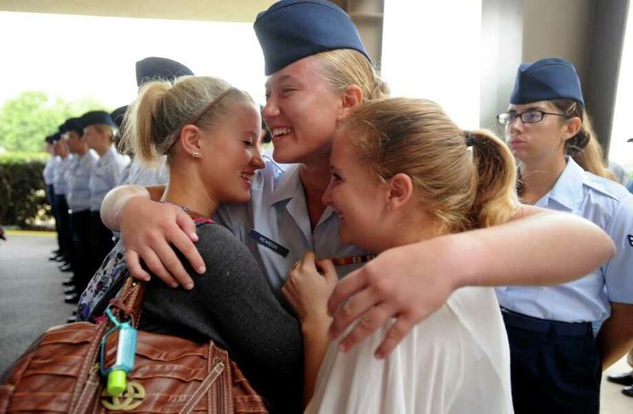 Airman Ashley Reardon is embraced by her sister, Joelyn, left, and Alannah Garvey Friday, Sept, 16, 2011 after completing basic training at Lackland Air Force Base. Photo: BILLY CALZADA, SAN ANTONIO EXPRESS-NEWS / gcalzada@express-news.net