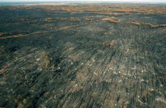 Damage from the Bastrop County Complex wildfire is seen in this Tuesday Sept. 20, 2011 aerial photo. The wildfire, which has become the most destructive in Texas' history, started September 5 and burned more than 34,000 acres. Officials announced Tuesday that electrical sparks started the fire. Photo: WILLIAM LUTHER, SAN ANTONIO EXPRESS-NEWS / 2011 SAN ANTONIO EXPRESS-NEWS