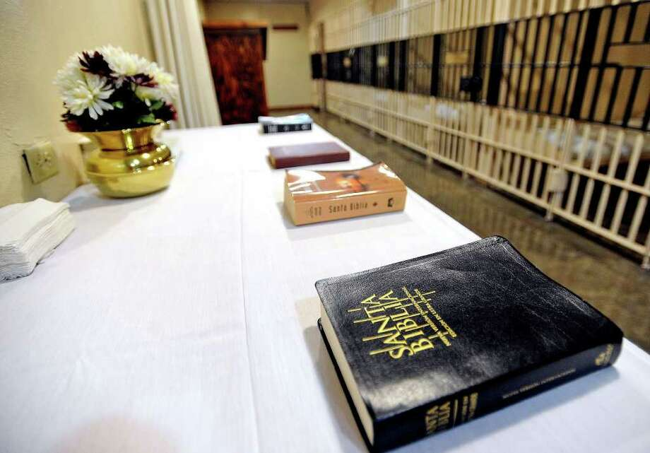 A variety of Bibles rest on a table in Texas' death house in Huntsville. Inmates spend their final day in these cells, where they receive a last meal before execution. Photo: Guiseppe Barranco / Beaumont