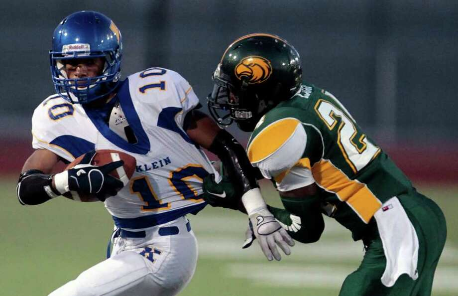 Klein High School wide receiver Ryan Jackson (10) is brought down by Klein Forest High School's Jon Ison (24) during the first quarter of a football game at Memorial Stadium Thursday, Sept. 22, 2011, in Klein. Photo: Cody Duty, Houston Chronicle / © 2011 Houston Chronicle