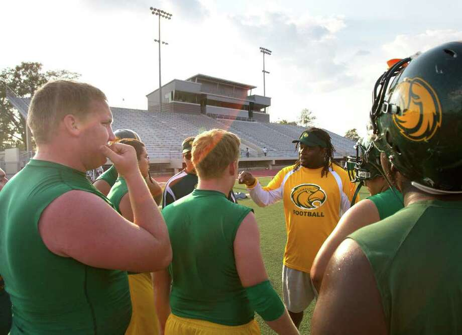 The Klein Forest offensive line talks before the start of the game. Photo: Cody Duty, Houston Chronicle / © 2011 Houston Chronicle