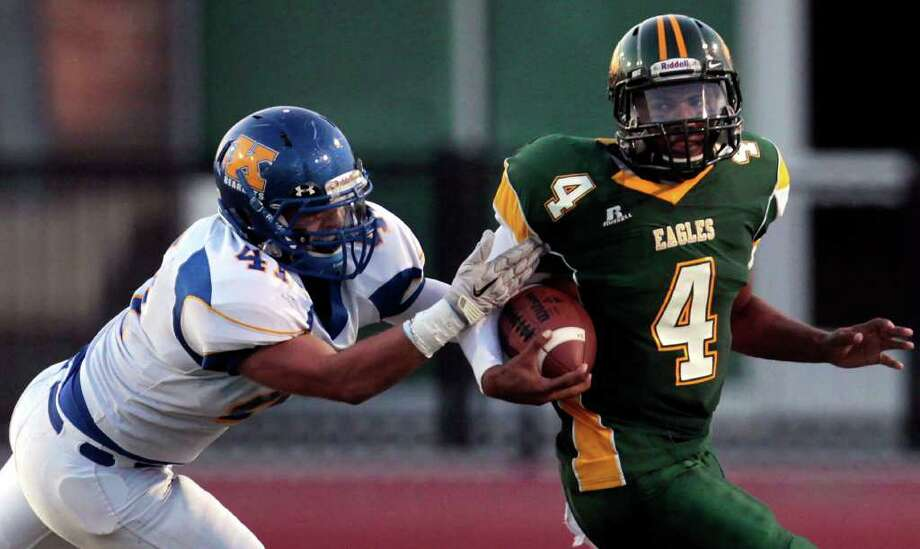 Klein linebacker Brooks Villarreal (41) brings down Klein Forest quarterback Matt Davis (4). Photo: Cody Duty, Houston Chronicle / © 2011 Houston Chronicle