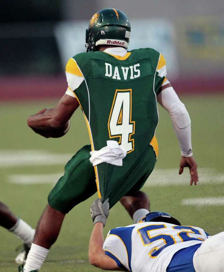 Klein defensive tackle Tyler Roach (52) brings down Klein Forest quarterback Matt Davis. Photo: Cody Duty, Houston Chronicle / © 2011 Houston Chronicle