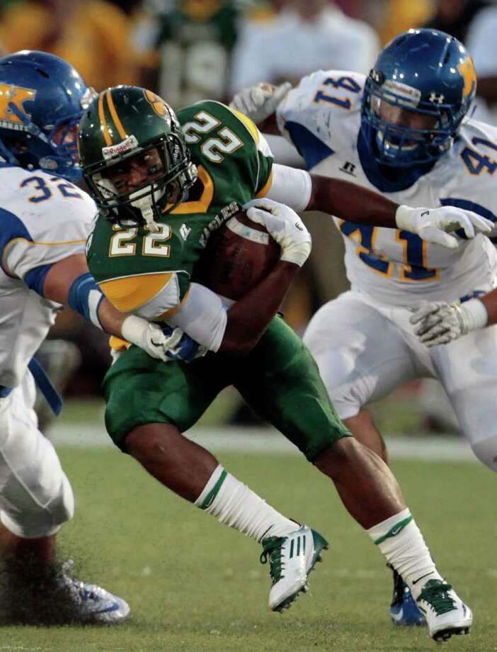 Klein Forest wide receiver Trent Richmond (22) looks for open room as Klein linebackers Ben Weaver (32) and Brooks Villarreal (41) apply pressure. Photo: Cody Duty, Houston Chronicle / © 2011 Houston Chronicle
