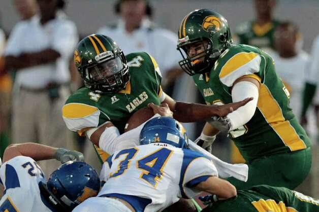 Klein Forest High School quarterback Matt Davis is brought down by Klein High School's Tyler Roche (52) and Chris Wade (34) during the first quarter of a football game at Memorial Stadium Thursday, Sept. 22, 2011, in Klein. Photo: Cody Duty, Houston Chronicle / © 2011 Houston Chronicle