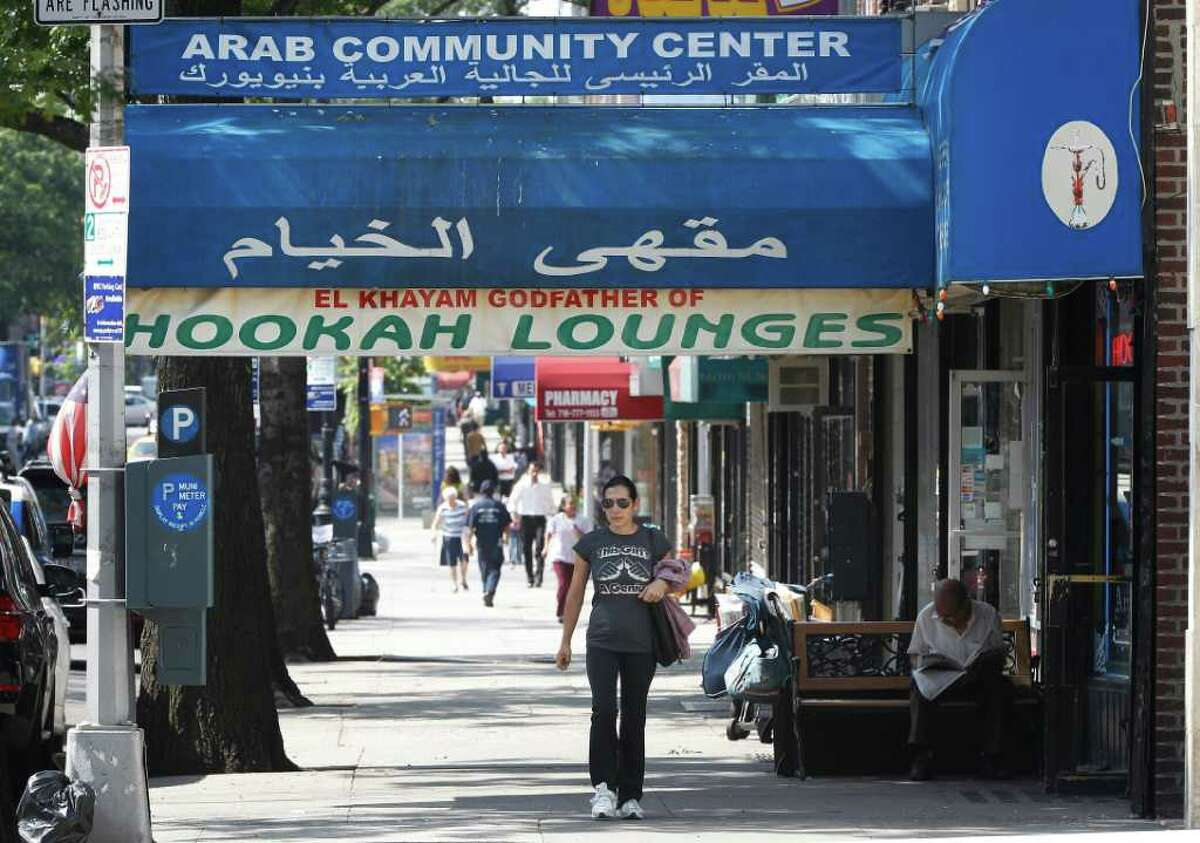 Immigrant Arab businesses are seen on Steinway Street in Astoria, N.Y., Friday, Sept. 2, 2011. The New York Police Department has subjected American citizens to surveillance and scrutiny, not because of any wrongdoing but because of their ethnicity. Documents obtained by The Associated Press describe a secret program known as the Moroccan Initiative, which catalogued where people of Moroccan ancestry shopped, ate and prayed. (AP Photo/Charles Dharapak)