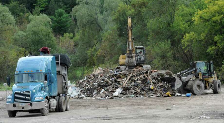 Refuse is gathered at a site near the Village of Schoharie, N.Y. as the cleanup from Irene continues September 22, 2011.  (Skip Dickstein/Times Union archive) Photo: Skip Dickstein / 2011