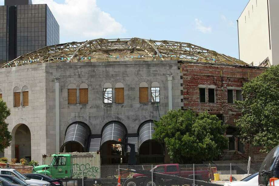 Demolition continues at the former Municipal Auditorium, Wednesday, Sept. 21, 2011. The municipal is undergoing a $195 million renovation that is scheduled for completion in 2014 and will convert it to the Tobin Center for the Performing Arts. Plans include a 1,750 H-E-B Performance Hall, a 230-seat Studio Theatre and a performing arts plaza. Photo: JERRY LARA, Jerry Lara/glara@express-news.net / SAN ANTONIO EXPRESS-NEWS