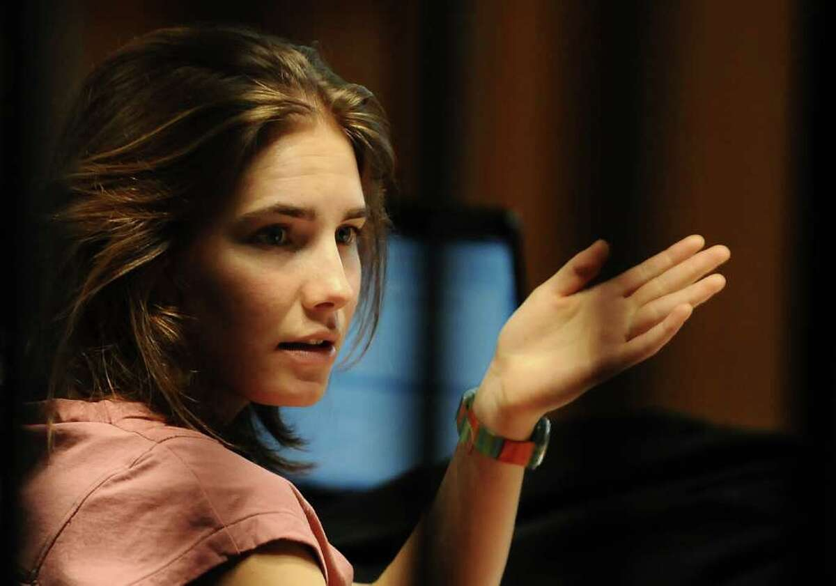 Amanda Knox gestures in court on Friday as her appeal trial against her conviction for the murder of British housemate Meredith Kercher is winding up, with prosecutors set to present their final arguments Knox was sentenced to 26 years in prison in 2009 but has always maintained her innocence, and the appeal hearing has cast serious doubts on the DNA evidence that helped convict her and her Italian boyfriend Raffaele Sollecito. AFP PHOTO/MARIO LAPORTA