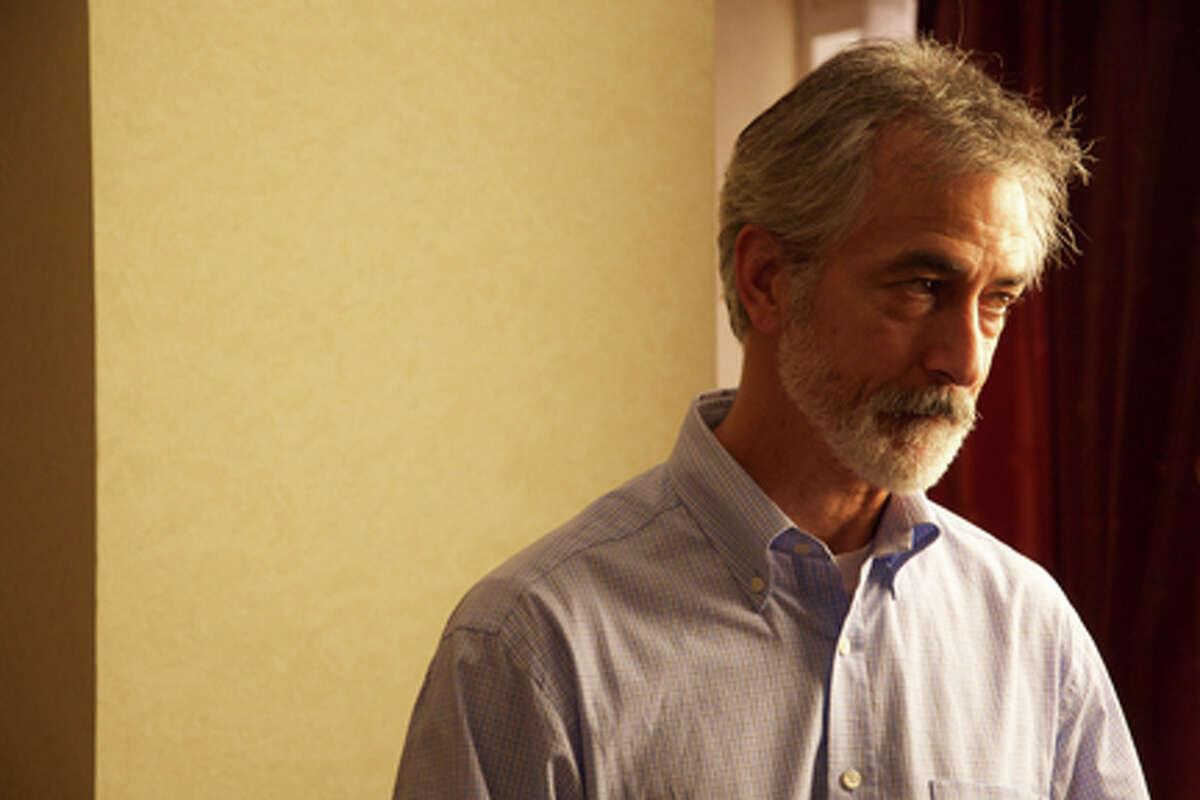 "David Strathairn as Peter Ward in ""The Whistleblower."""