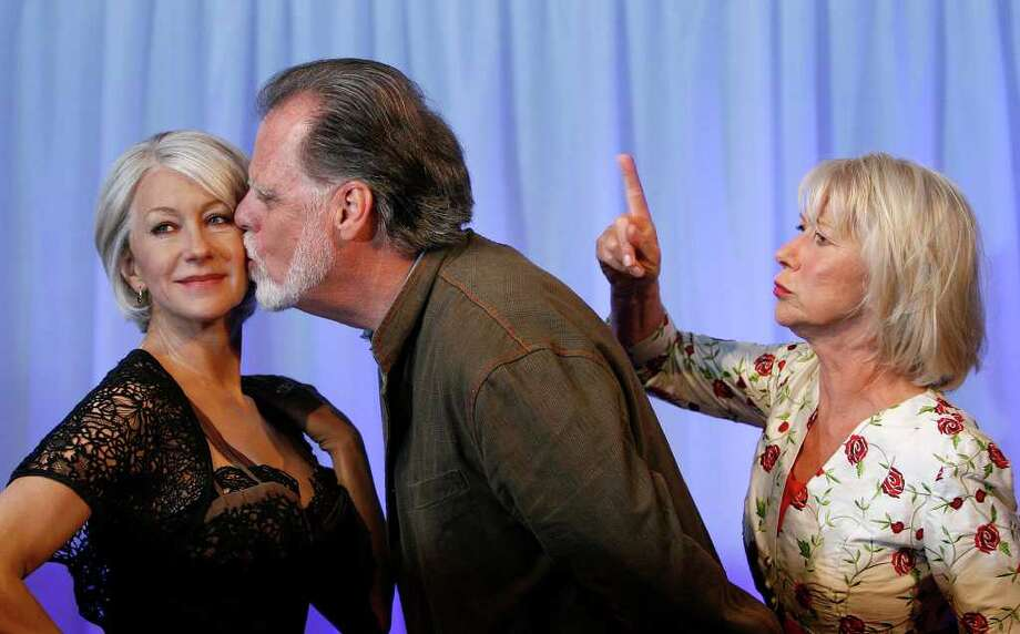 British actress Helen Mirren, right, look on as her husband Taylor Hackford kisses a wax figure of herself at Madame Tussauds in London. Photo: Akira Suemori, AP / AP
