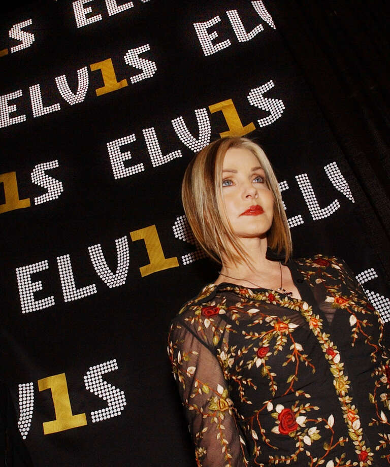 """This is the real Priscilla Presley at a party celebrating the release of """"Elvis 30 #1 Hits"""" at the Hard Rock Cafe."""