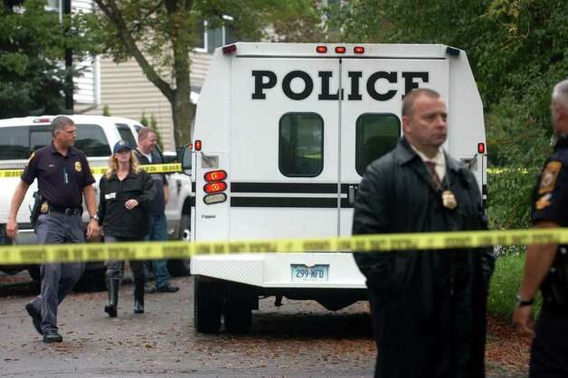 Milford Police officers on the scene at Branca Court on Friday, Sept. 23rd, 2011, where two bodies were found in a single family home, the result of a possible murder-suicide. Photo: Ned Gerard / Connecticut Post