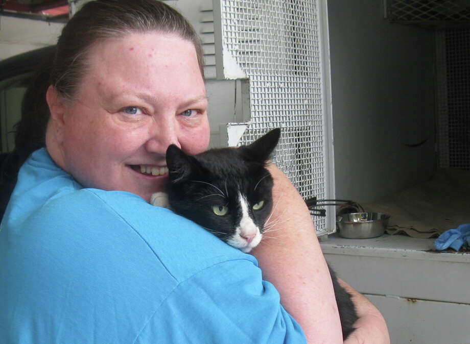 Oscar the cat reunites with owner Sherrie Fox on Sept. 22, 2011, three years after disappearing from his Auburn home. He was found in SeaTac. (Photo courtesy Regional Animal Services of King County).