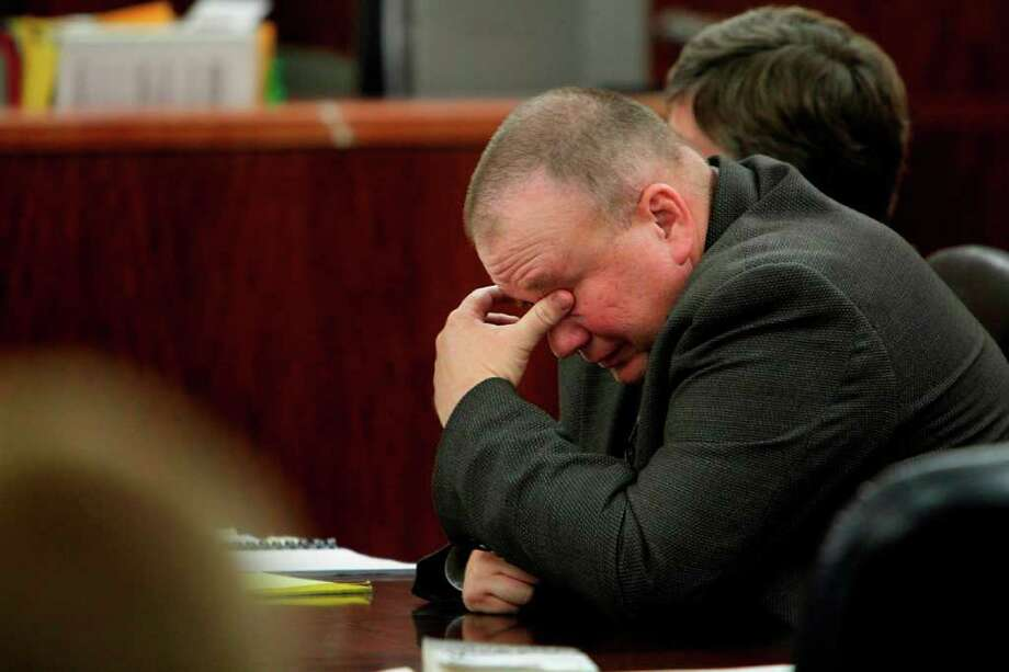 Former Houston police officer Matthew Calley, 46, weeps after his brother takes the stand during sentencing on Thursday in Houston. Photo: Mayra Beltran, Houston Chronicle / © 2011 Houston Chronicle