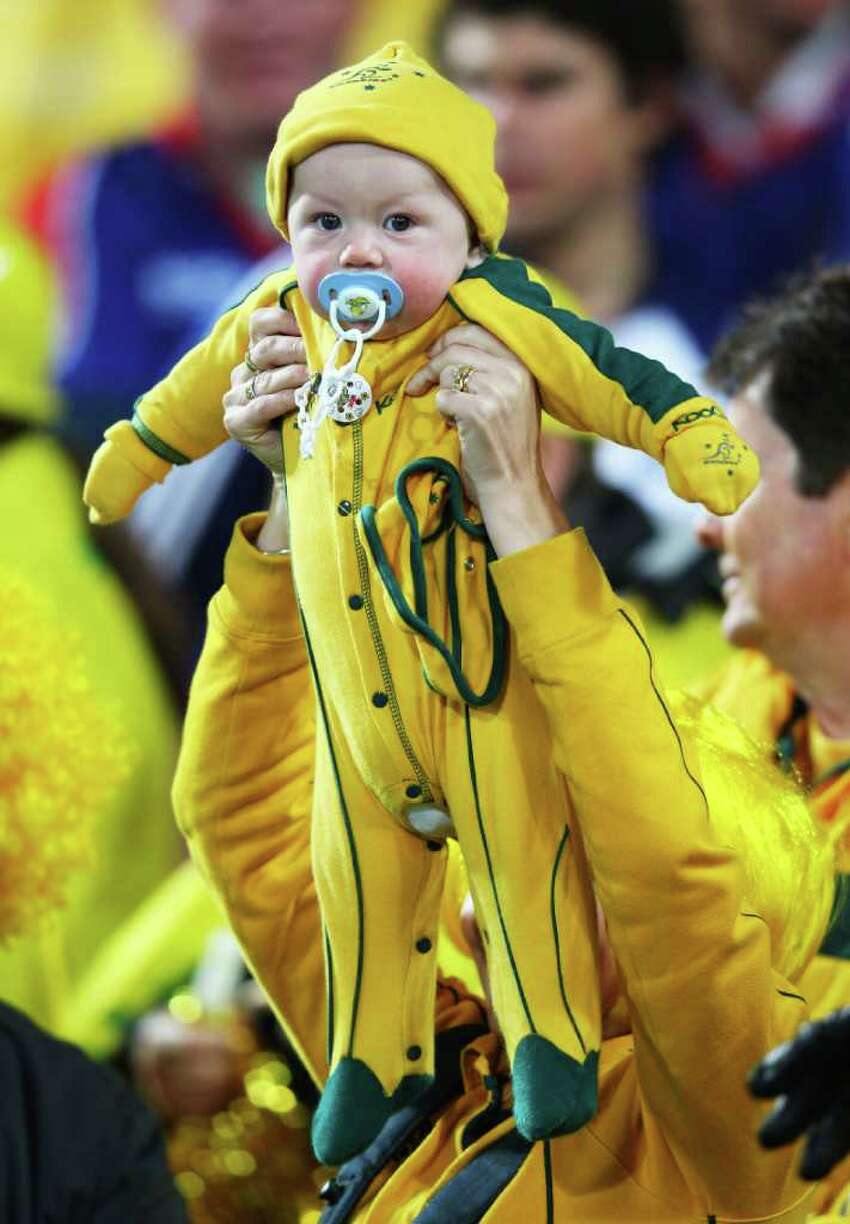 WELLINGTON, NEW ZEALAND - SEPTEMBER 23: A young Australian fan looks on during match 23 of the IRB 2011 Rugby World Cup between Australia and the USA at Wellington Regional Stadium on September 23, 2011 in Wellington, New Zealand.