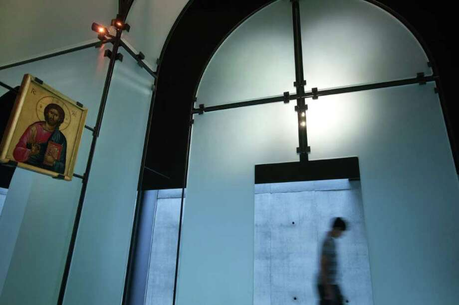 Visitors wander the glass chapel at the Byzantine Fresco Chapel. Photo: Smiley N. Pool, Houston Chronicle / © 2011  Houston Chronicle