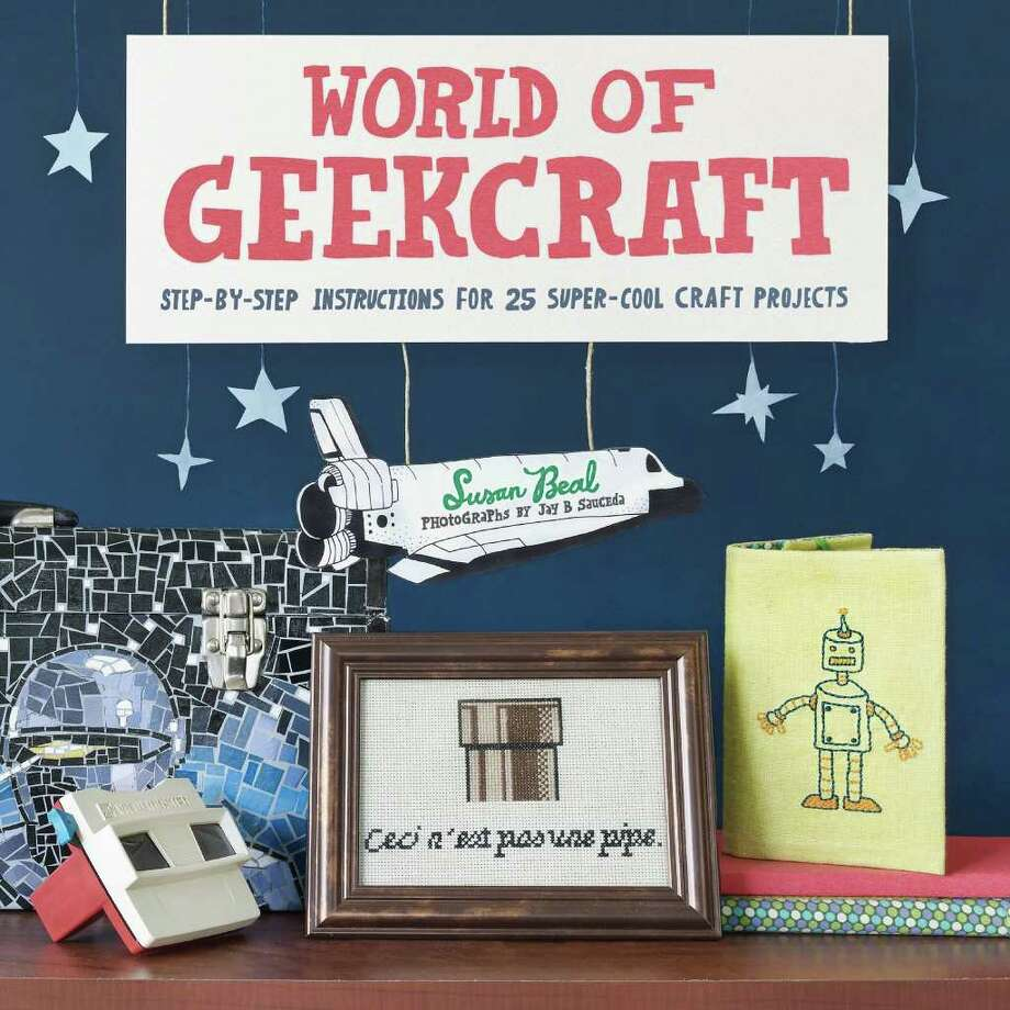 """""""World of Geekcraft: Step-by-Step Instructions for 25 Super-Cool Craft Projects"""" by Susan Beal. The book's projects include POW! ZAP! magnets and """"Star Wars"""" terrariums."""