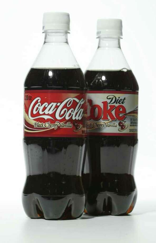CokeIt would take the average American 62 minutes of walking at a 20-minute mile pace to burn off the 240 calories in a 20-oz bottle of Coke.  Photo: Buster Dean / Houston Chronicle