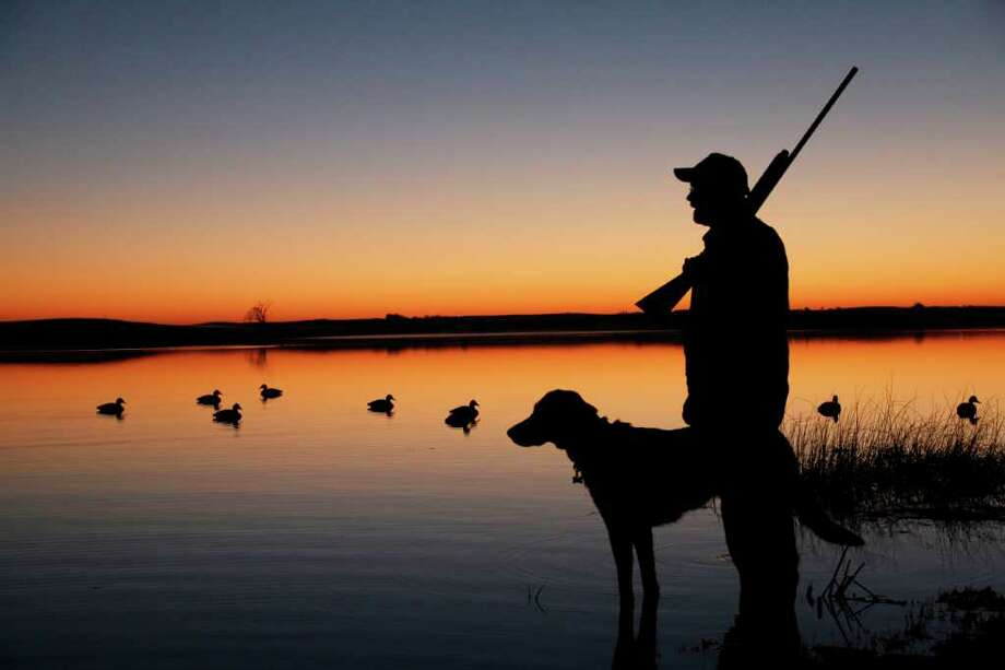 CHRONICLE FILE OPEN SEASON: A duck hunter prepares for the day amid Southeast Texas' coastal marshes. Prairie wetlands provide habitat for fish and wildlife. / handout email
