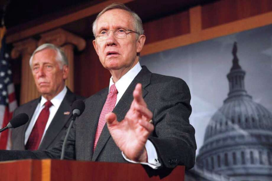 Senate Majority Leader Harry Reid of Nev., right, accompanied by House Minority Whip Steny Hoyer of Md. gestures during a news conference on Capitol Hill in Washington, on Friday, Sept. 23, 2011, to discuss the continuing resolution to keep the government open. (AP Photo/Jacquelyn Martin) Photo: Jacquelyn Martin / AP