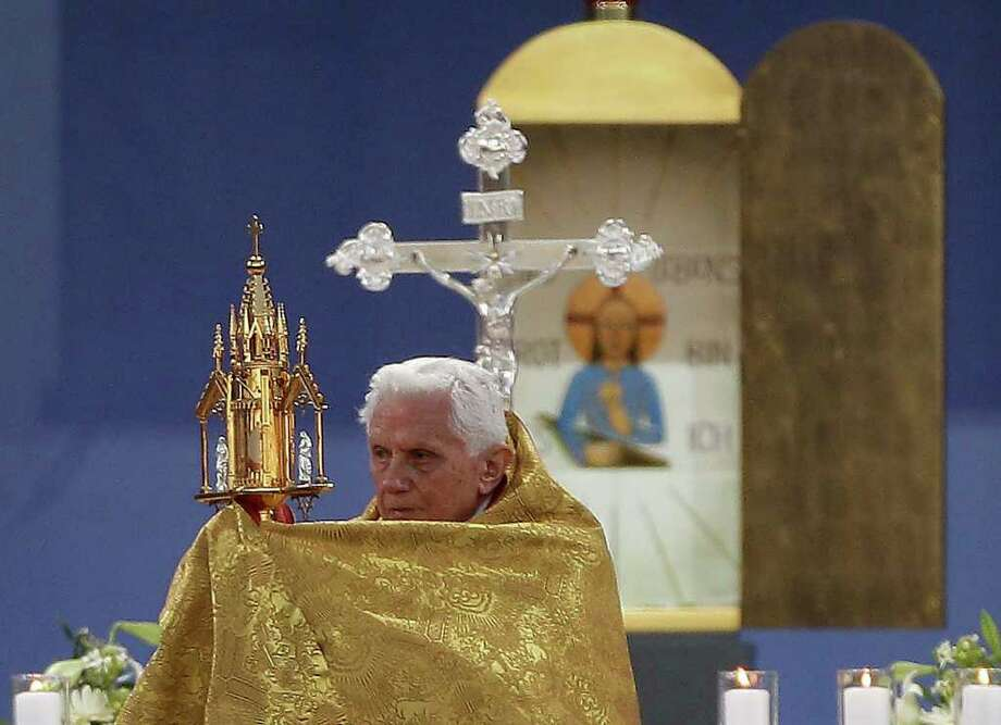 Pope Benedict XVI  holds the monstrance as he celebrates a Vesper service in Etzelsbach, Germany, Friday, Sept. 23, 2011.  Pope Benedict XVI is on a four-day official visit to his homeland Germany.  (AP Photo/Frank Augstein) Photo: Frank Augstein / AP