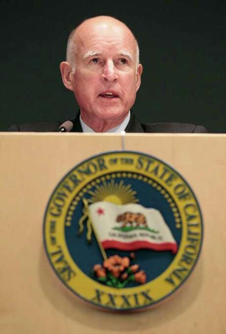 California Gov. Jerry Brown speaks before signing AB 155, a bill that requires Amazon.com and other Internet retailers to collect sales taxes starting next year, at a news conference in San Francisco, Friday, Sept. 23, 2011. (AP Photo/Jeff Chiu) Photo: Jeff Chiu / AP