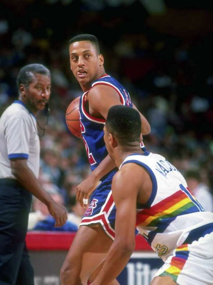 1991-1992:  Guard Tate George of the New Jersey Nets looks on during a game against the Denver Nuggets at the McNichols Sports Arena in Denver, Colorado. Mandatory Credit: Tim DeFrisco  /Allsport Mandatory Credit: Tim DeFrisco  /Allsport Photo: Tim DeFrisco, Getty Images / Getty Images North America