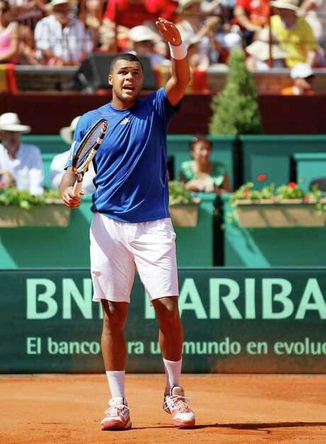 France's Jo-Wilfried Tsonga reacts during his Davis Cup semi-final match against Spain's Rafael Nadal on September 18, 2011 at Cordoba's bullring, southern Spain. Rafael Nadal secured the winning point to give Spain a 3-1 victory over France and a place in the Davis Cup final. AFP PHOTO / CESAR MANSO (Photo credit should read CESAR MANSO/AFP/Getty Images) Photo: CESAR MANSO / AFP