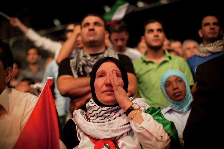 BERNAT ARMANGUE : ASSOCIATED PRESS SEEKING STATEHOOD: A woman cries during the speech of President Mahmoud Abbas at the General Assembly of the U.N., in the West Bank city of Ramallah, Friday. Photo: Bernat Armangue / AP