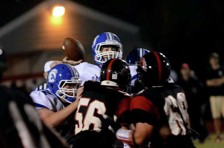 Darien's Henry Baldwin (5) throws a pass during the Fairfield Warde vs Darien football game at Fairfield Warde High School on Friday, Sept. 23, 2011. Photo: Amy Mortensen / Connecticut Post Freelance