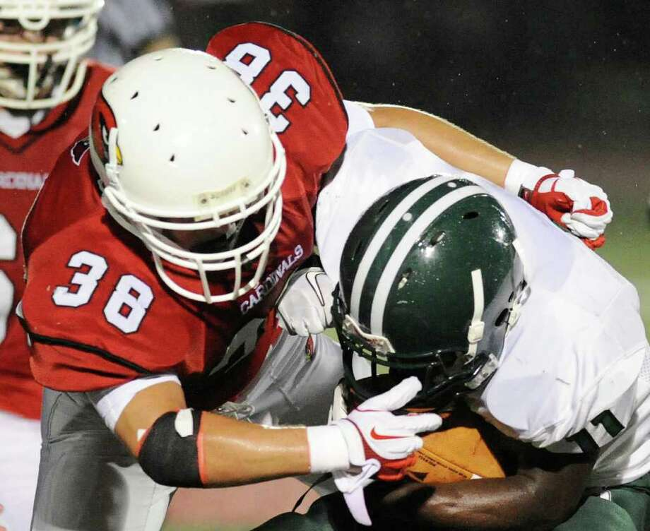 Dan Claroni, # 38 of Greenwich High School, tackles Tevin McFadden, # 11 of Bassick High School, during Football game between Bassick High School of Bridgeport and Greenwich High School at Greenwich, Friday night, Sept. 23, 2011. Photo: Bob Luckey / Greenwich Time